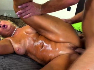 Blonde MILF enjoys her massage and a big cock