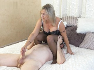 Ala gets on top of slave and gives foot job and facesits wearing nylons.